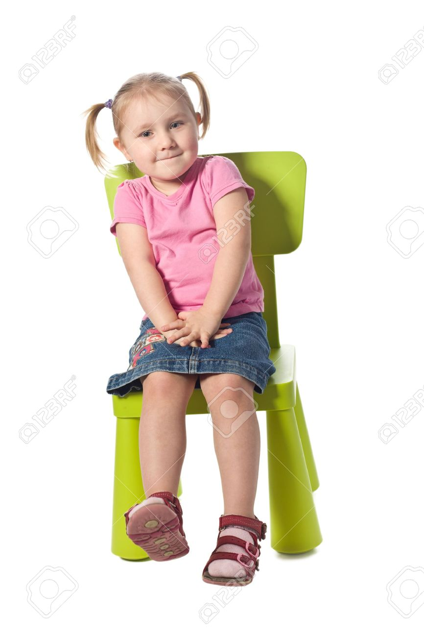 the little child sits on a chair Stock Photo - 8719082