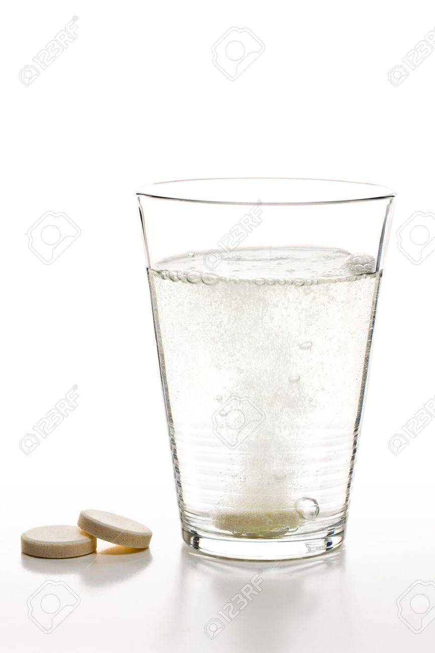 the effervescent tablets and glass with water - 9086889