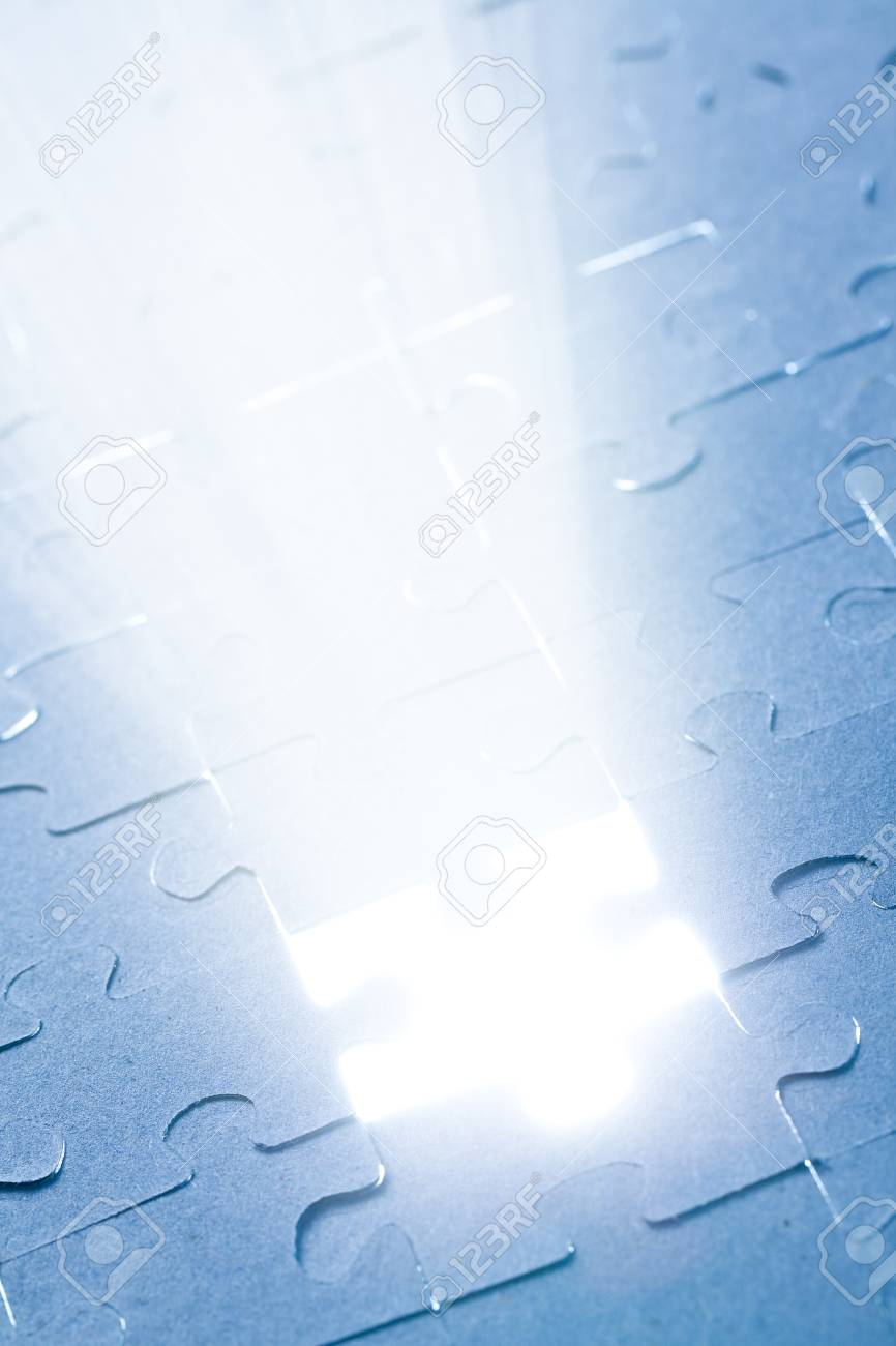 the jigsaw puzzle with white light Stock Photo - 9122364