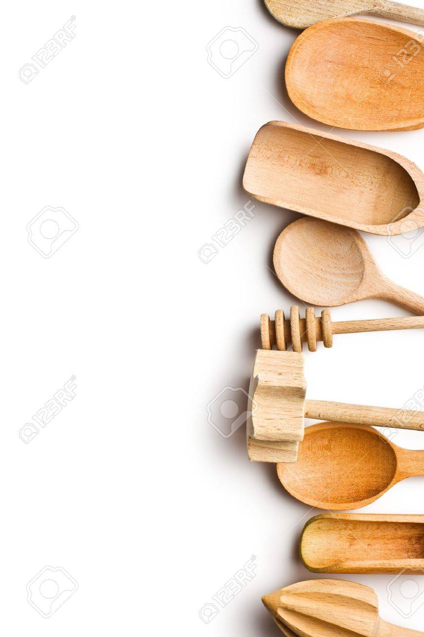 Kitchen Utensils Background border of wooden kitchen utensils on white background stock photo