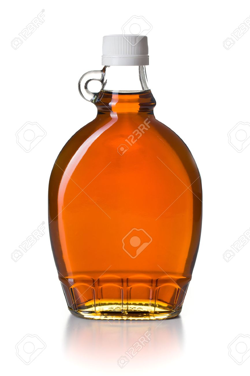 b66f9357cfc maple syrup in glass bottle on white background Stock Photo - 23107726
