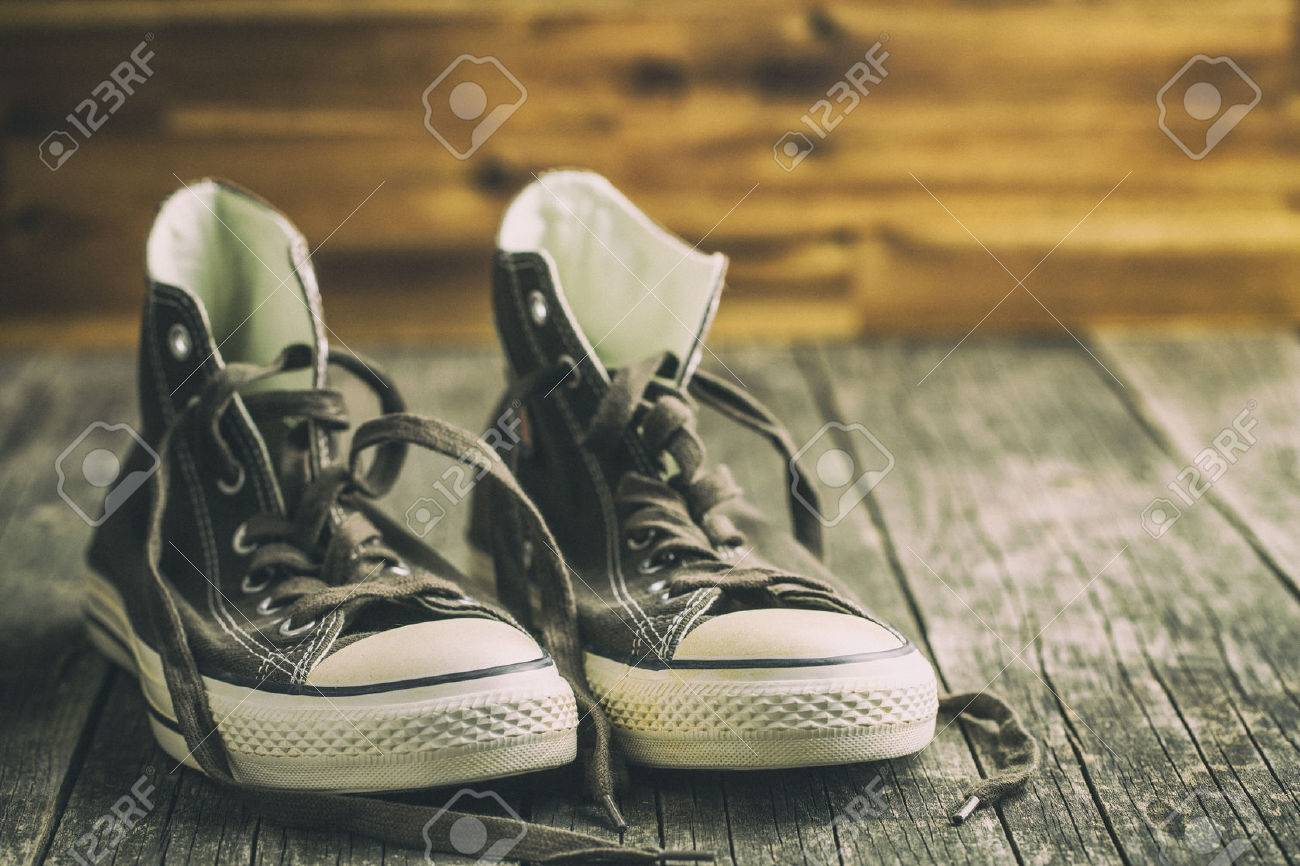 The Vintage Sneakers Before Wooden Wall