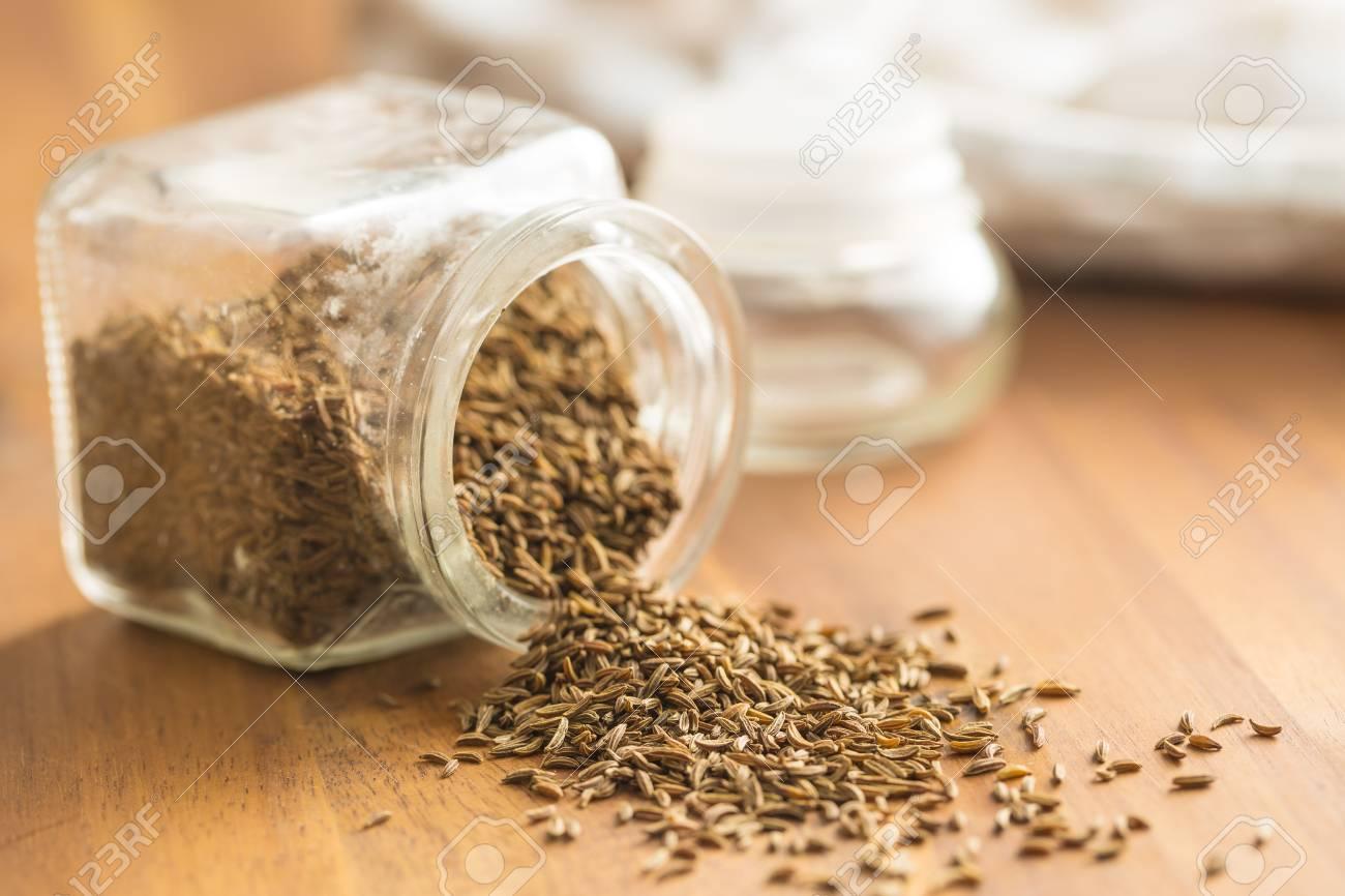 Cumin seeds or caraway in jar. - 75868823