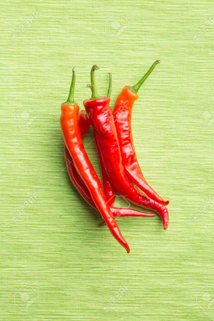 Exceptionnel Red Chili Peppers On Green Tablecloth. Stock Photo   86496893