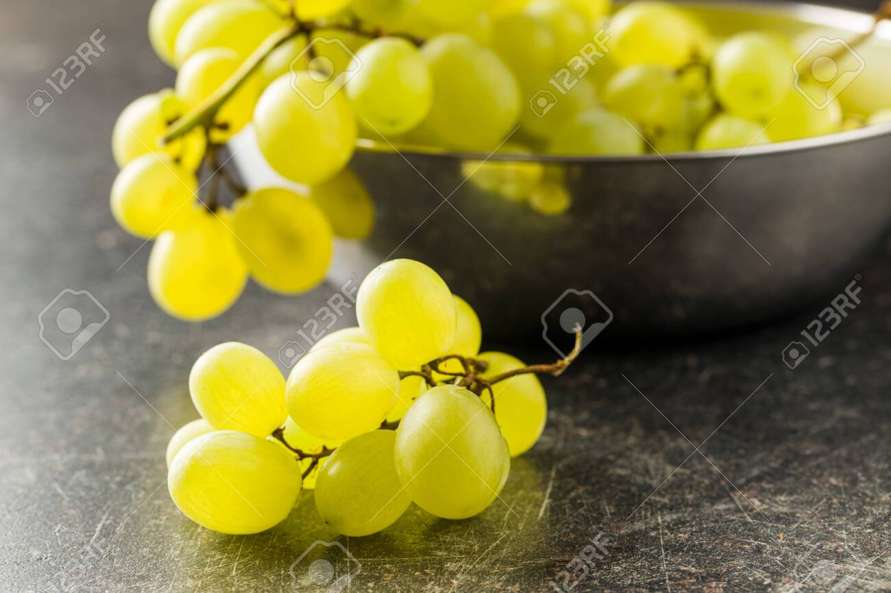 Tasty Green Grapes White Grape On Old Kitchen Table Stock Photo Picture And Royalty Free Image 128236951