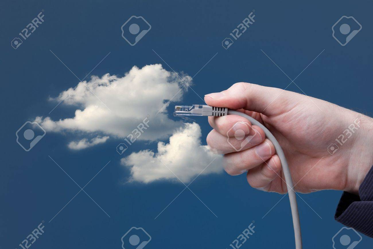Cloud computing concept. Hand with ethernet cable connecting into cloud. Stock Photo - 11847414
