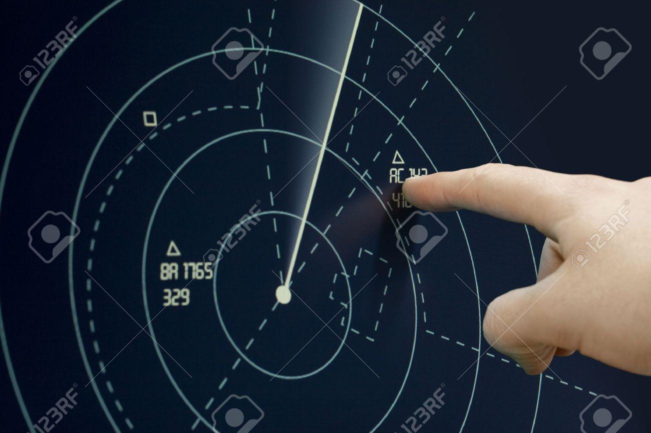 Air traffic controller point to plane on radar (sonar) - Air Traffic Control Tower Stock Photo - 11943716