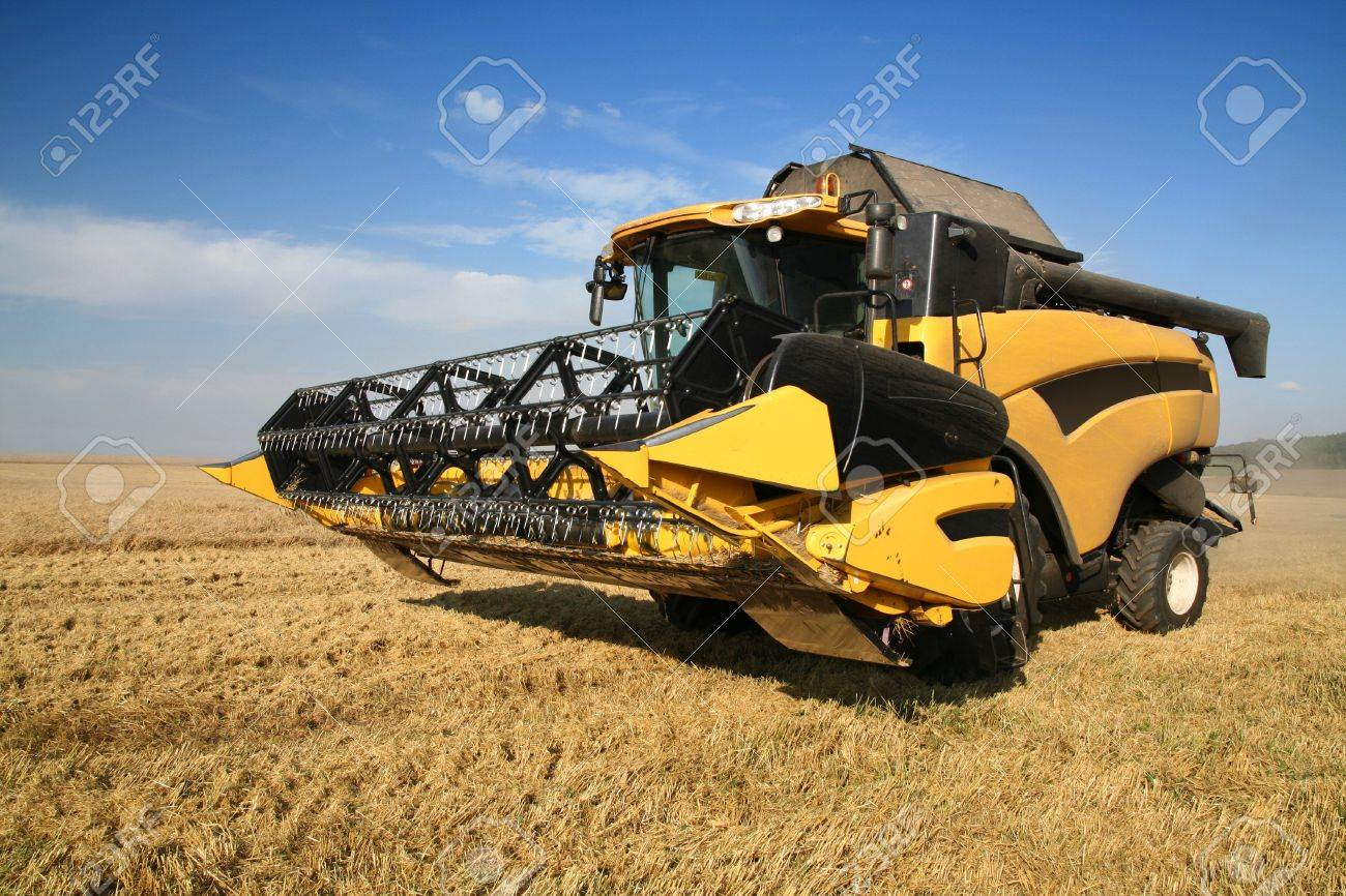Agriculture - Combine (harvester) on the field Stock Photo - 11940994