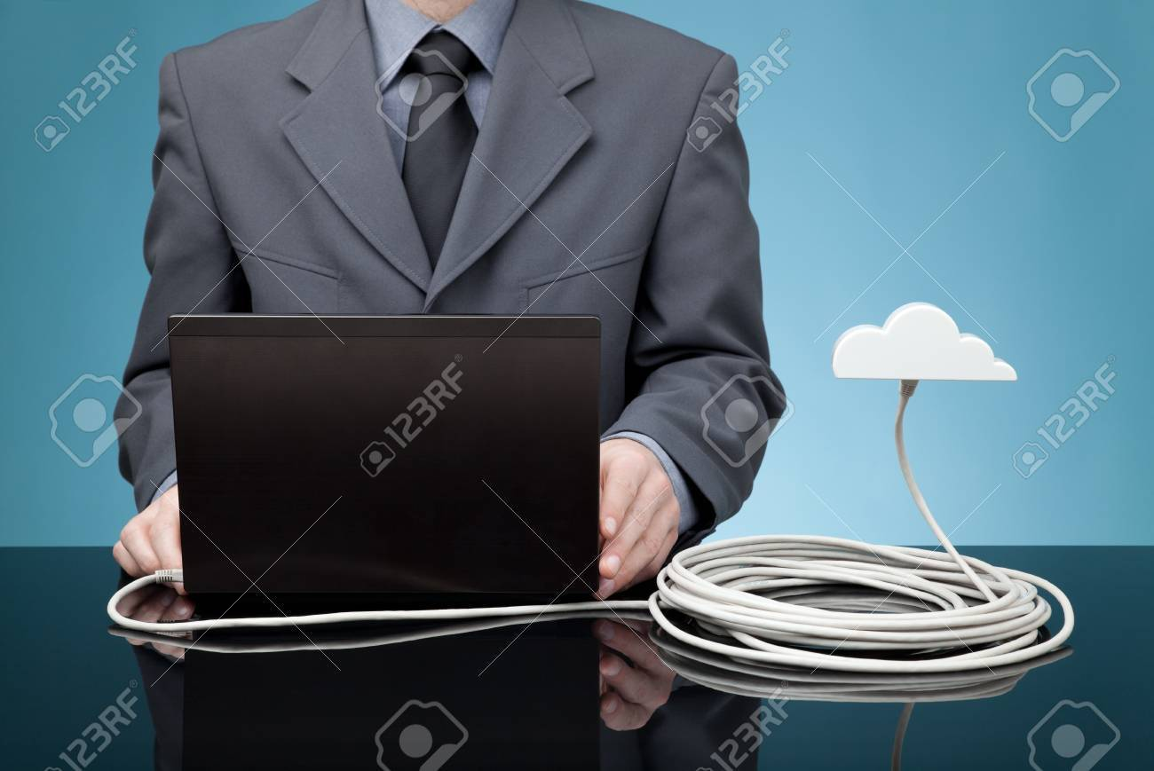 Cloud computing concept  Man send data from laptop to cloud via ethernet cable Stock Photo - 18857002