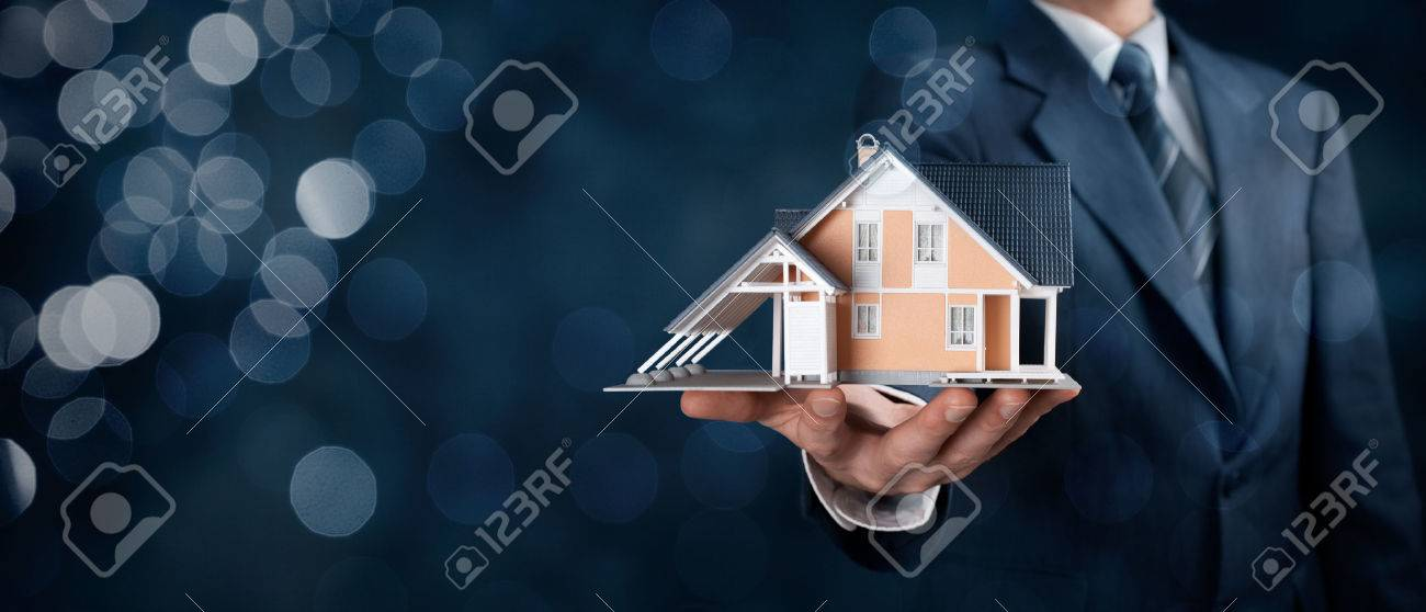 Real estate agent offer house represented by model. Wide banner composition with bokeh background. - 50233251