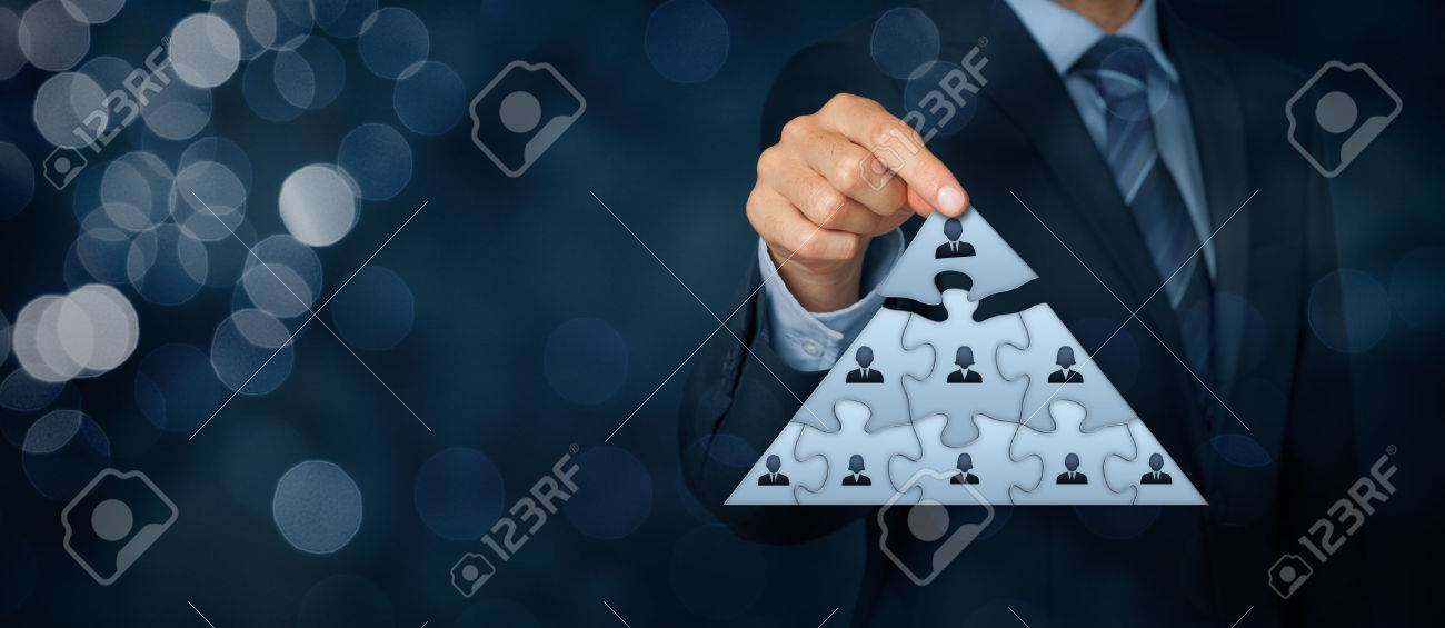 CEO, leadership and corporate hierarchy concept - recruiter complete team represented by puzzle in pyramid scheme by one leader person (CEO). Wide banner composition with bokeh in background. - 51291258