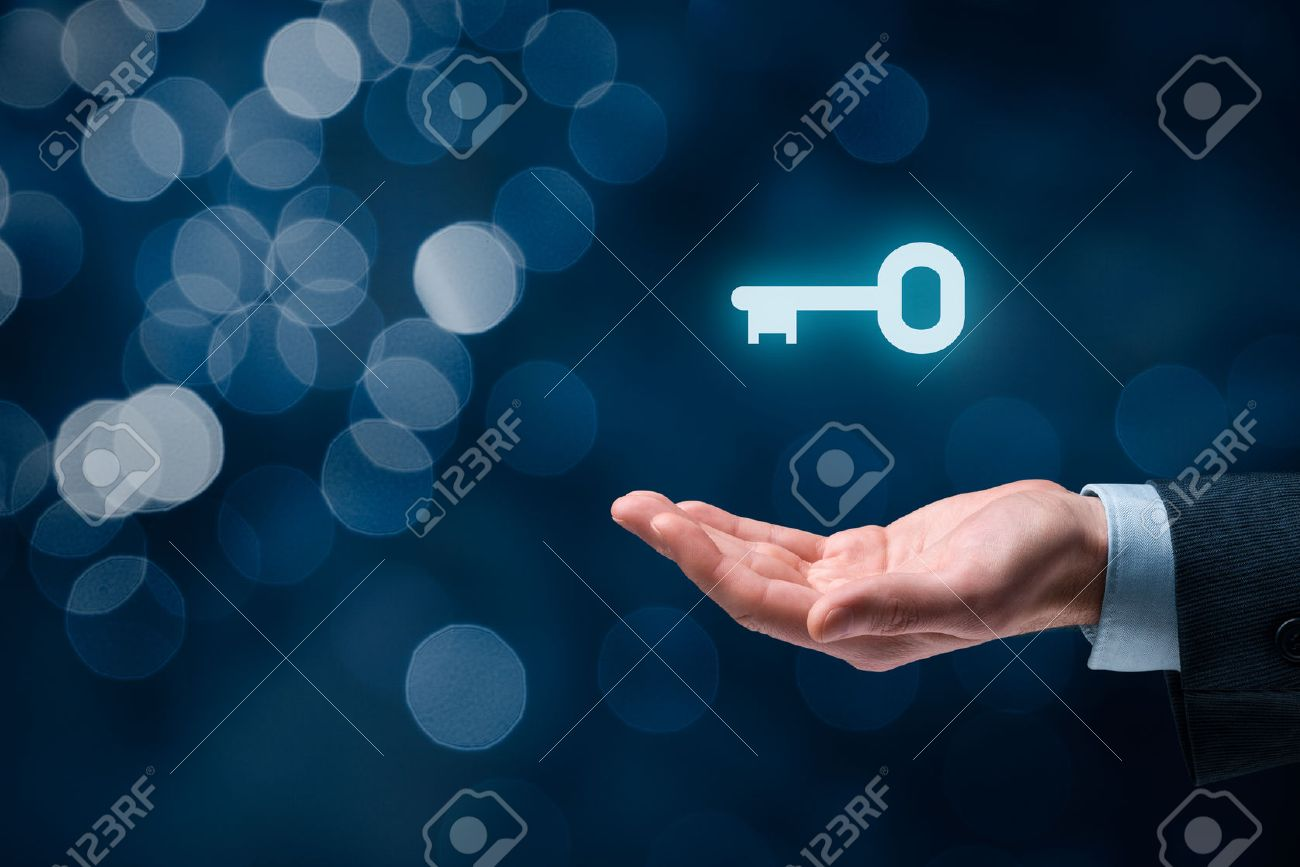 Businessman (consultant, coach, leader, CEO or another business person) offer key to success. Turnkey solution and services concept, bokeh in background. - 52117472