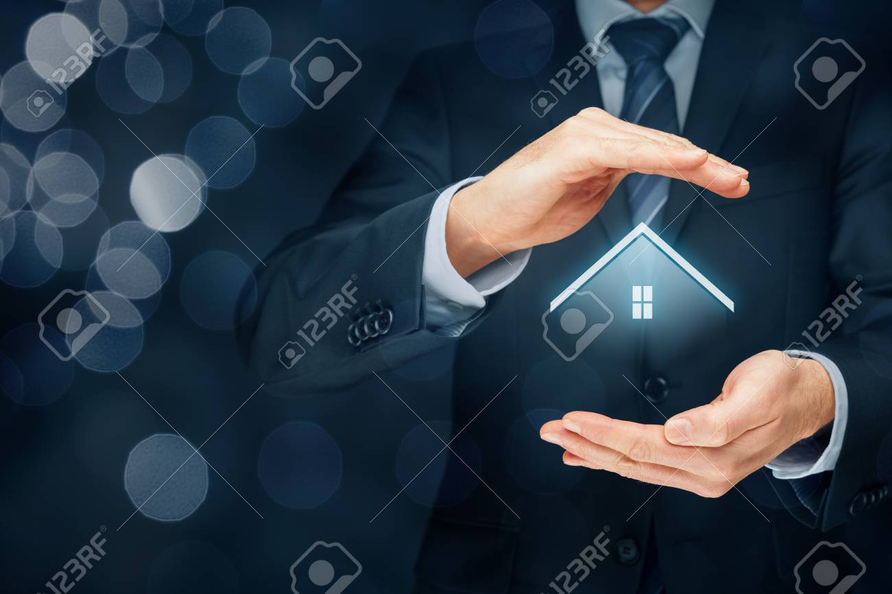 Real estate agent offer house. Property insurance and security concept. Right composition with bokeh in background. - 70701964