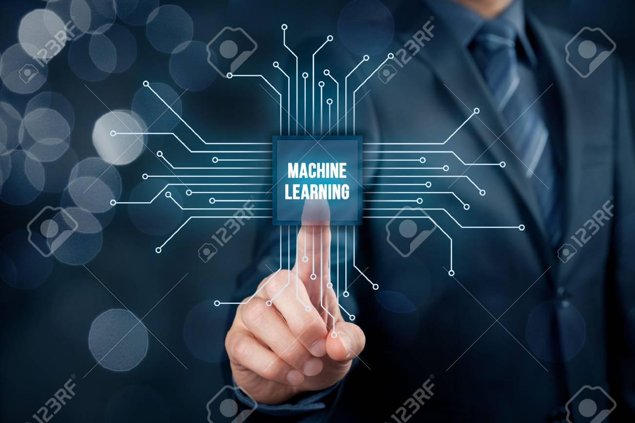 Machine learning data analysis concept. Businessman or programmer with abstract symbol of a chip with text machine learning connected with data represented by points. - 71744155