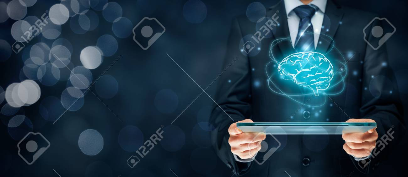 Artificial intelligence (AI), machine deep learning, data mining, expert system software, and another modern computer technologies concepts. Brain representing artificial intelligence and businessman holding futuristic tablet. - 71744093