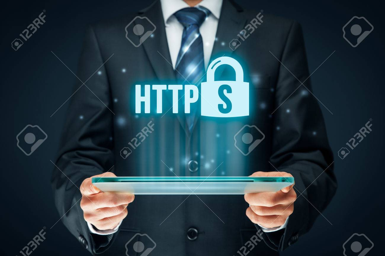 HTTPS - secured internet concept. Businessman or programmer with tablet and https text and padlock symbol. - 72736069