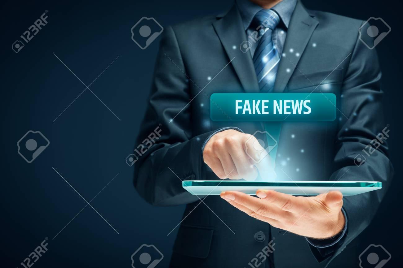 Fake news concept. Tablet user read fake news. - 95621623