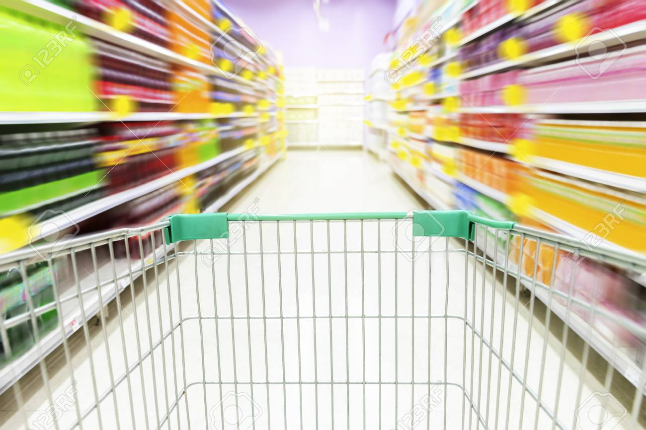 Supermarket Aisle With Empty Green Shopping Cart The Image Is Stock Photo Picture And Royalty Free Image Image 110853614