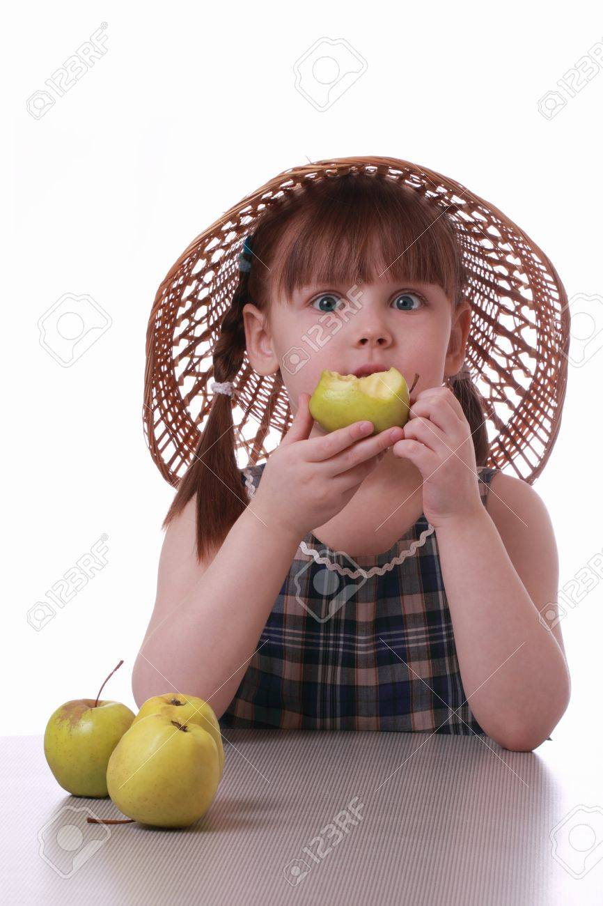 A little girl eating a tasty apple Stock Photo - 12537611