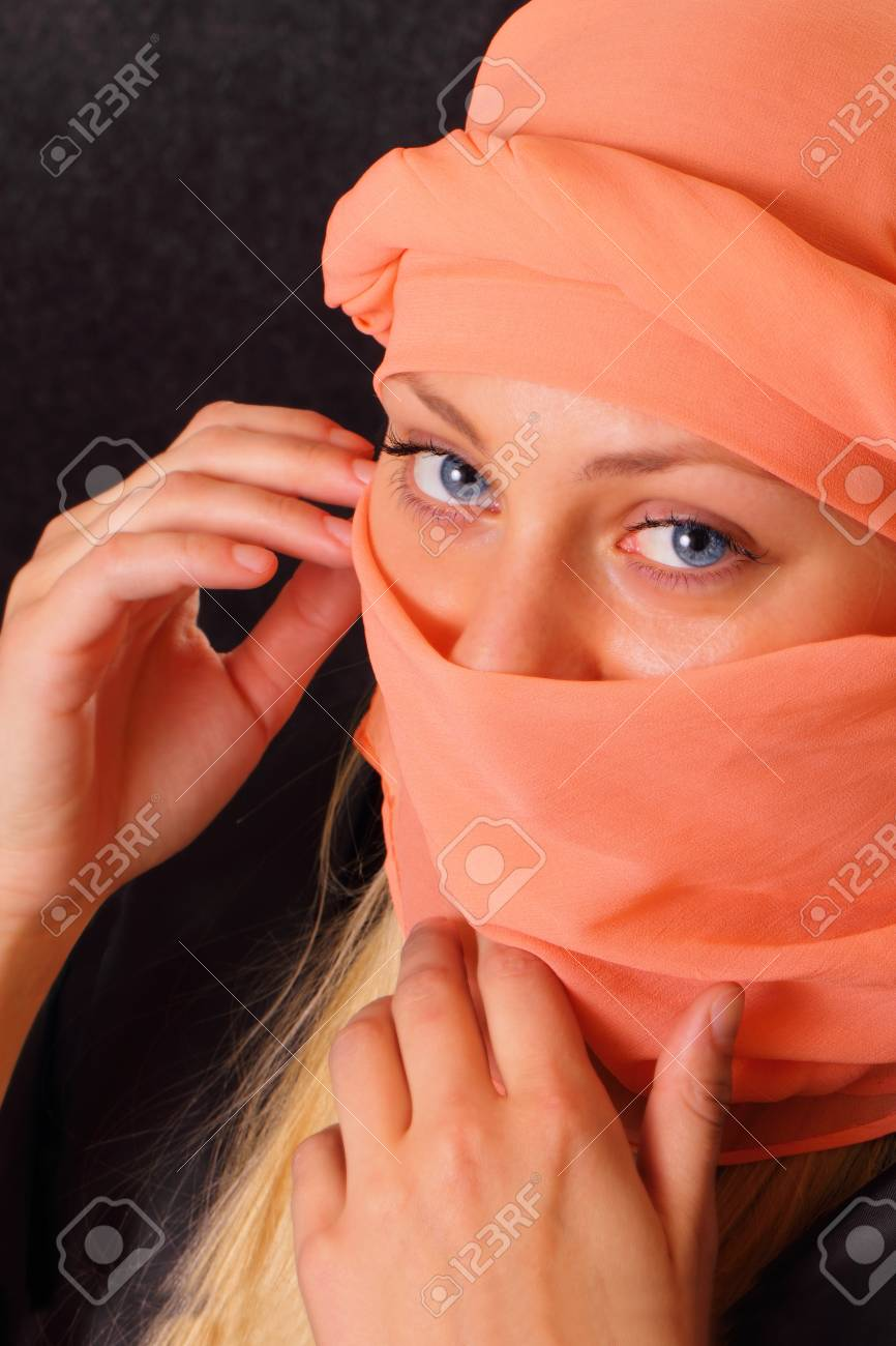 Mysterious blonde woman in cape Stock Photo - 16254076