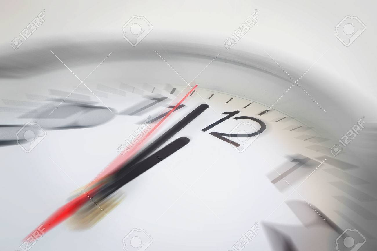 Close up of the hands of clock pointing nearly at 12 o'clock, business concept on deadline or rush hour. Using radial blur effect at 12 o'clock and rest is blurred. - 44708228