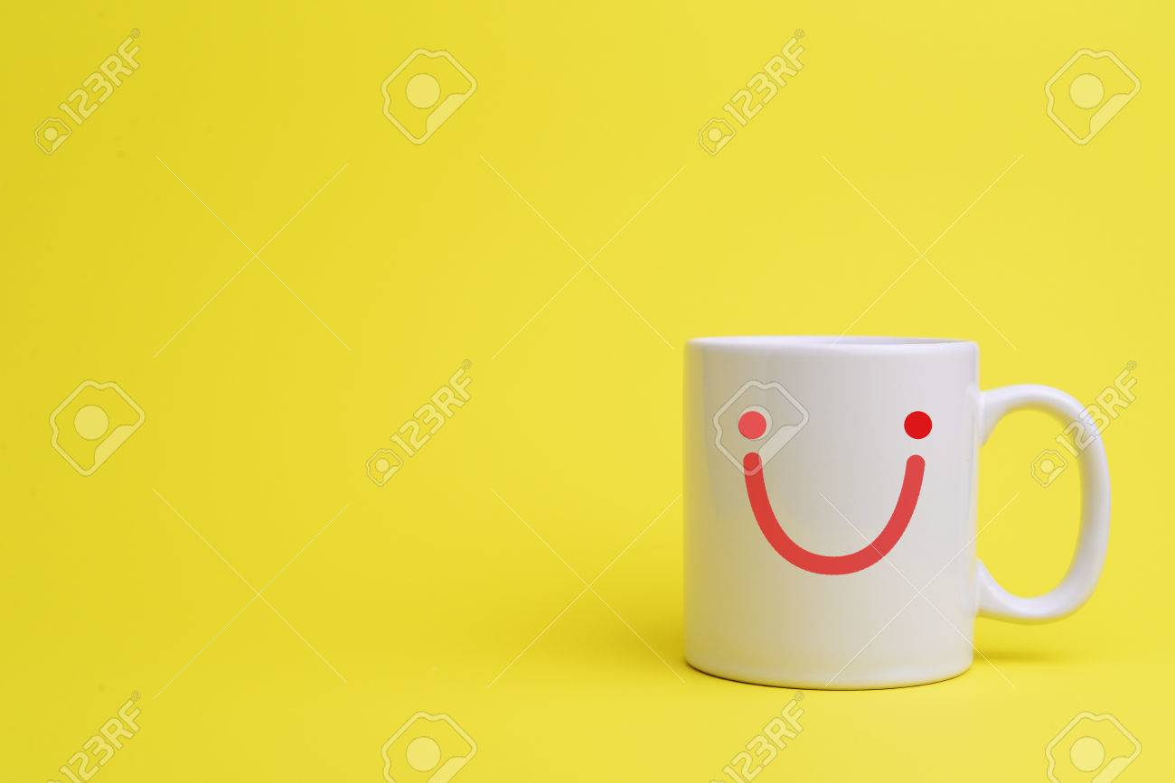 Smiley Face Coffee Mug White Cup Of Coffee On Yellow Background With Smiley Face And