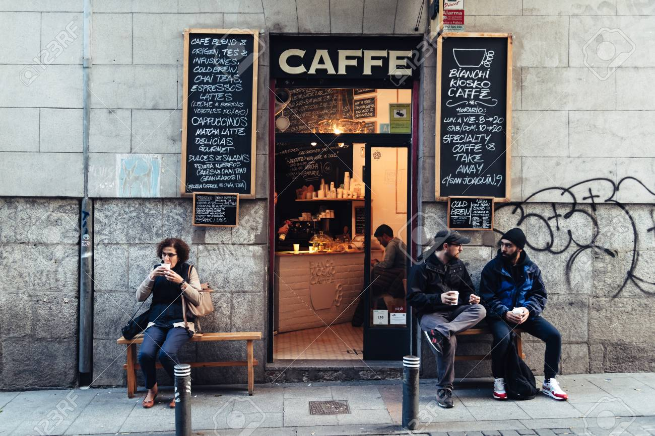People Drinking Coffee Outside Hipster Cafe In Malasana Distric Stock Photo Picture And Royalty Free Image Image 105179632