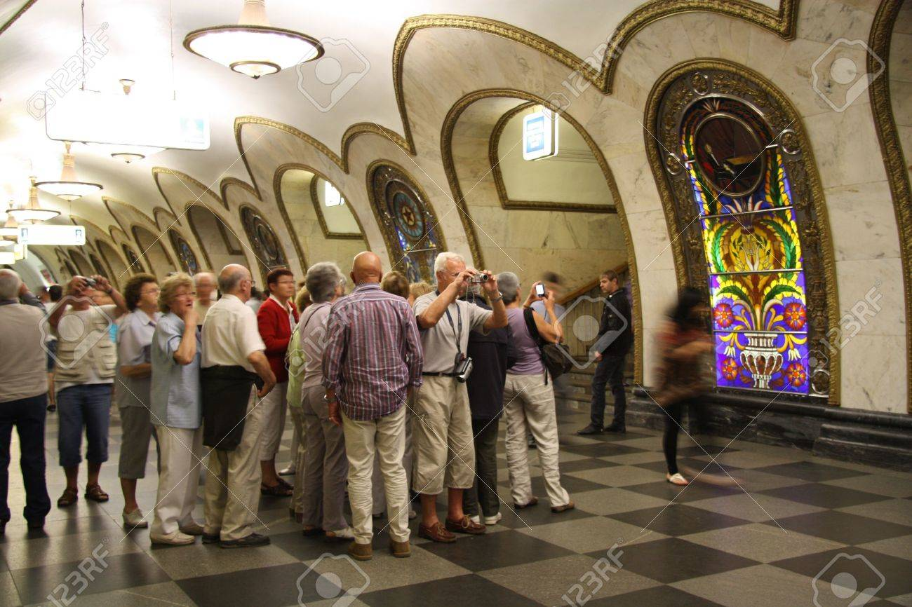 Tourist group in Moscow metro, Novoslobodskaya station, Russia 24.06.2011 Stock Photo - 9777330