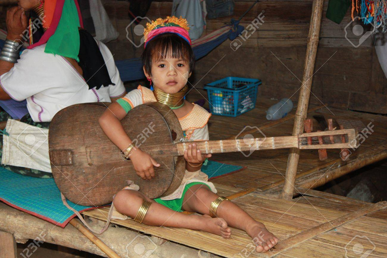 Karen Child playing guitar, Northern Thailand, Chiang Mai - 31.07.2011 Stock Photo - 13072903