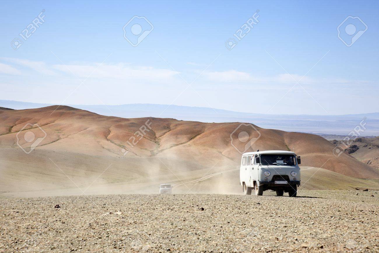 a van across the desert at high speed leaving a trail of dust Stock Photo - 17049513