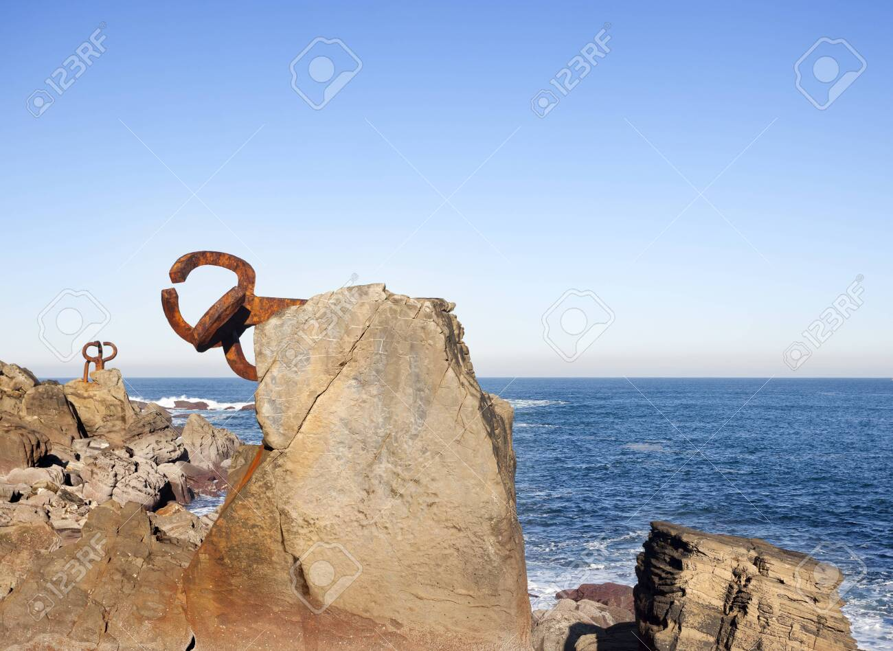 Donosti, Spain-December 22, 2014: On sunny days,in the end of the la Concha beach you can see Chillida's sculptures - 121836733