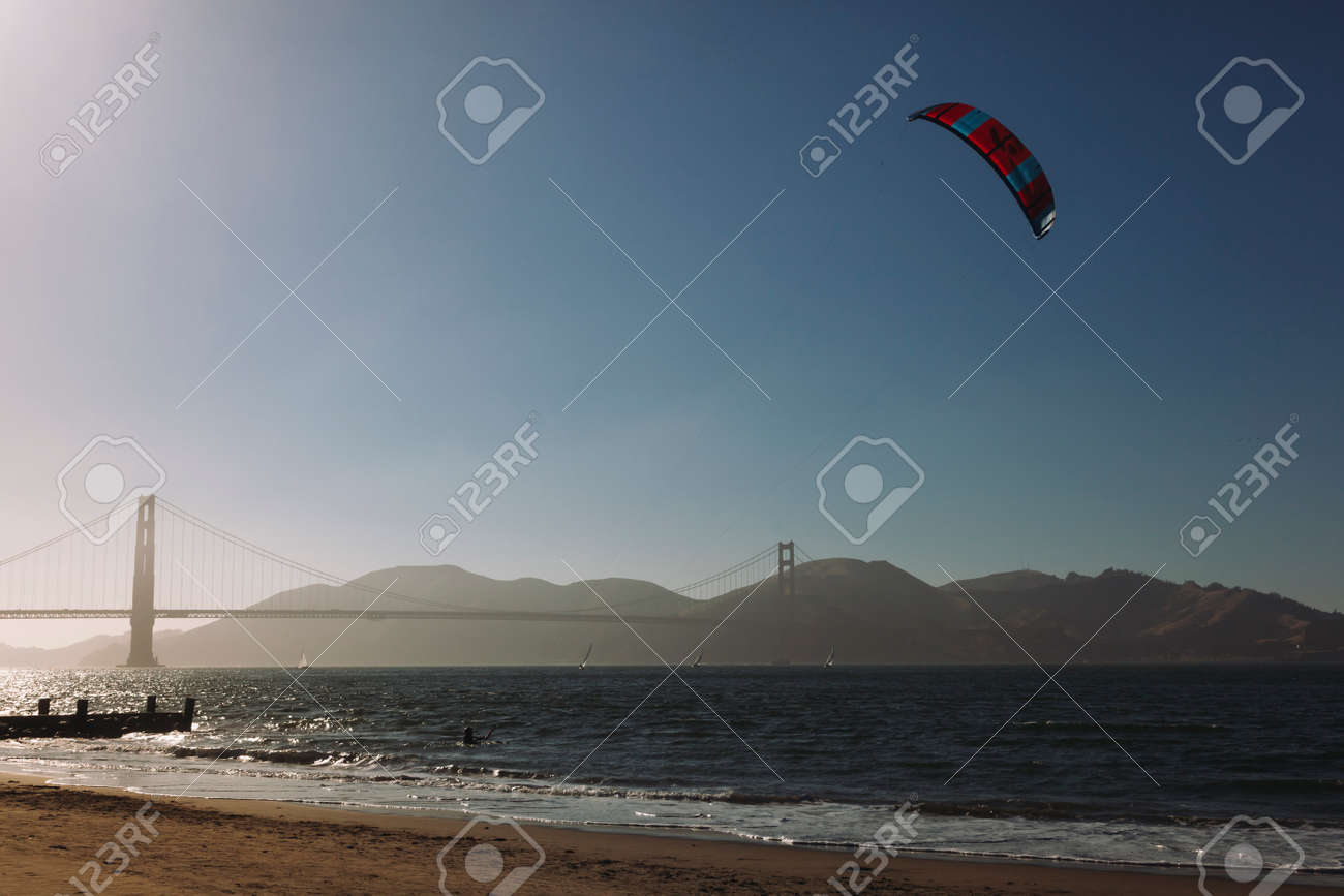 San Franciso, CA, USA-June 22, 2017: Kitesurfing under the Golden Gate Bridge. San francisco California - 166981209