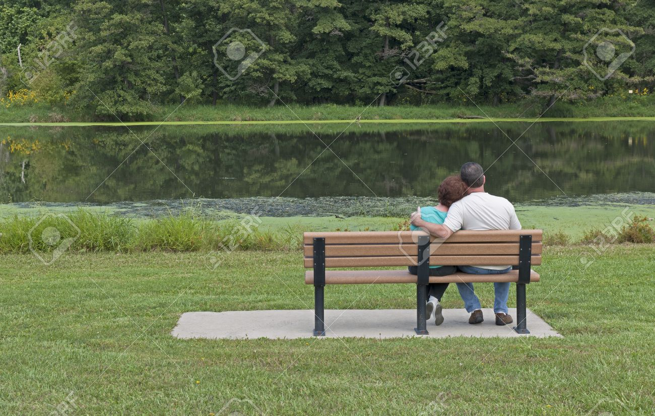Couple In Love Sitting On A Park Bench In Spring Stock Photo