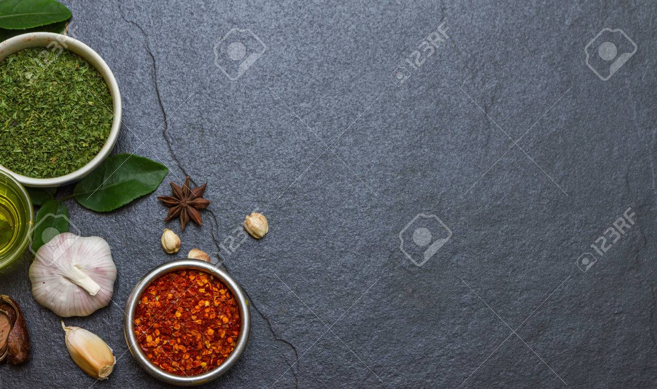 Mixed spices and herbs on background for decorate design. Stock Photo - 41557004