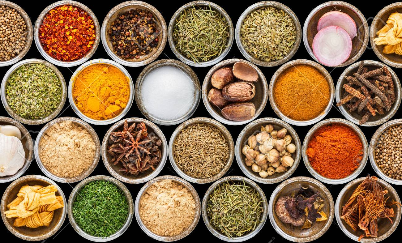 Spices and herbs in metal bowls background for decorate and design project. Stock Photo - 42744912