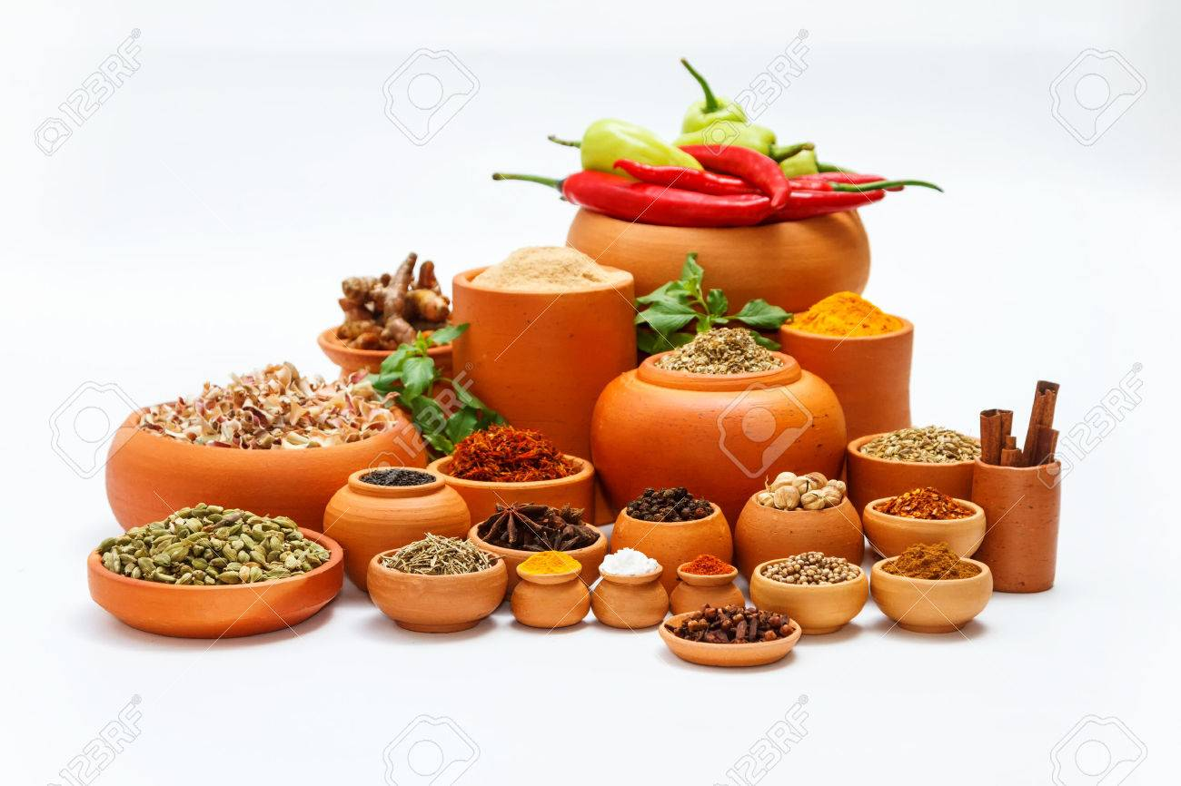 Spices and herbs on white background for decorate spices content,indian spices in terracotta pots, indian colourful spices,group of indian spices,Spices arranged in different size terracotta pots Stock Photo - 58916772