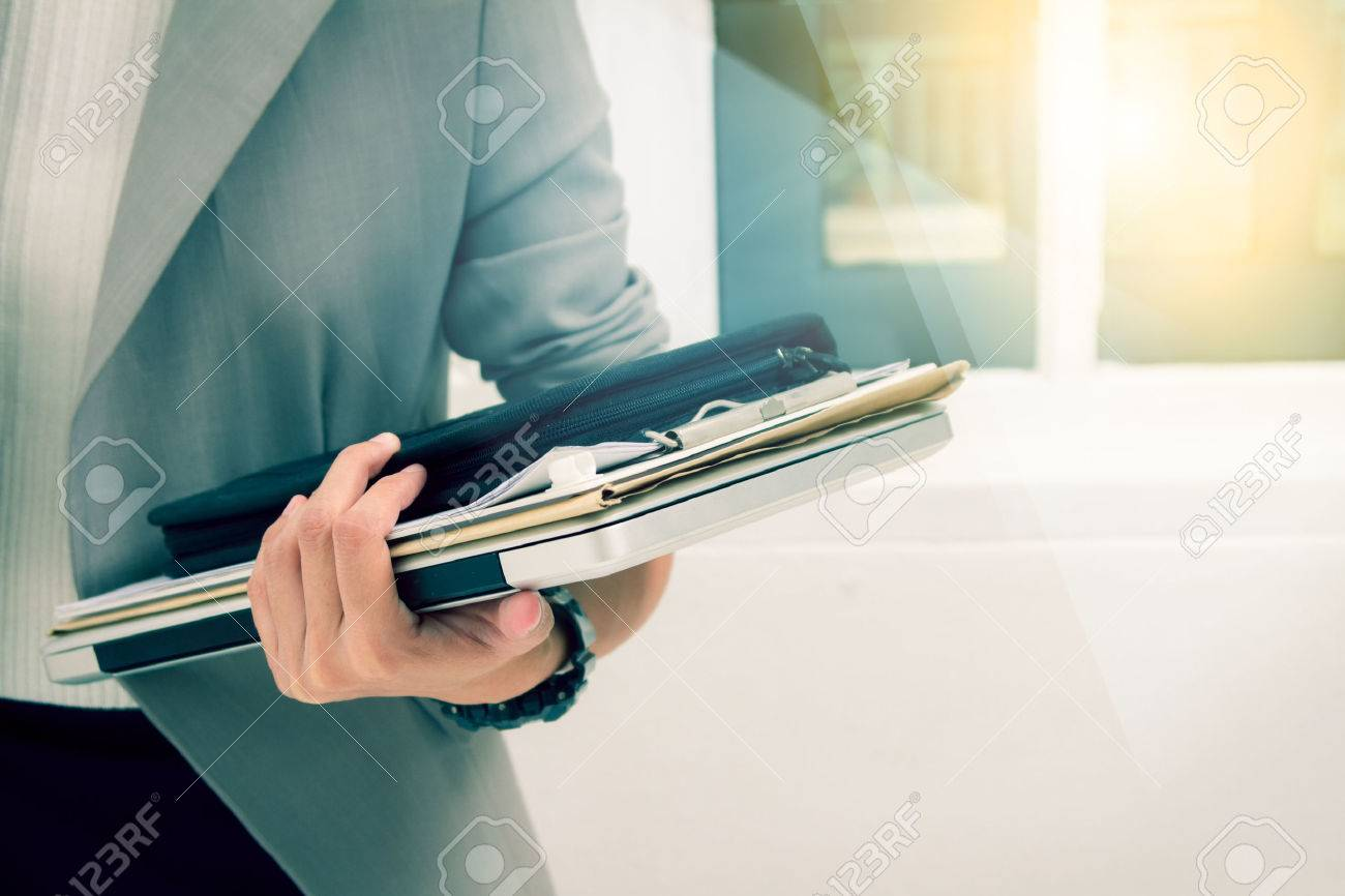 Business woman prepare documents and graph business diagram and business people working in the background,business content,business background and film effect. Stock Photo - 64915511