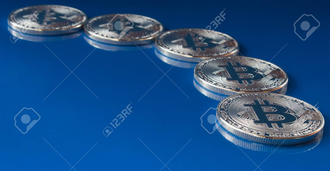 On a blue background are bitcoins of a digital crypto currency