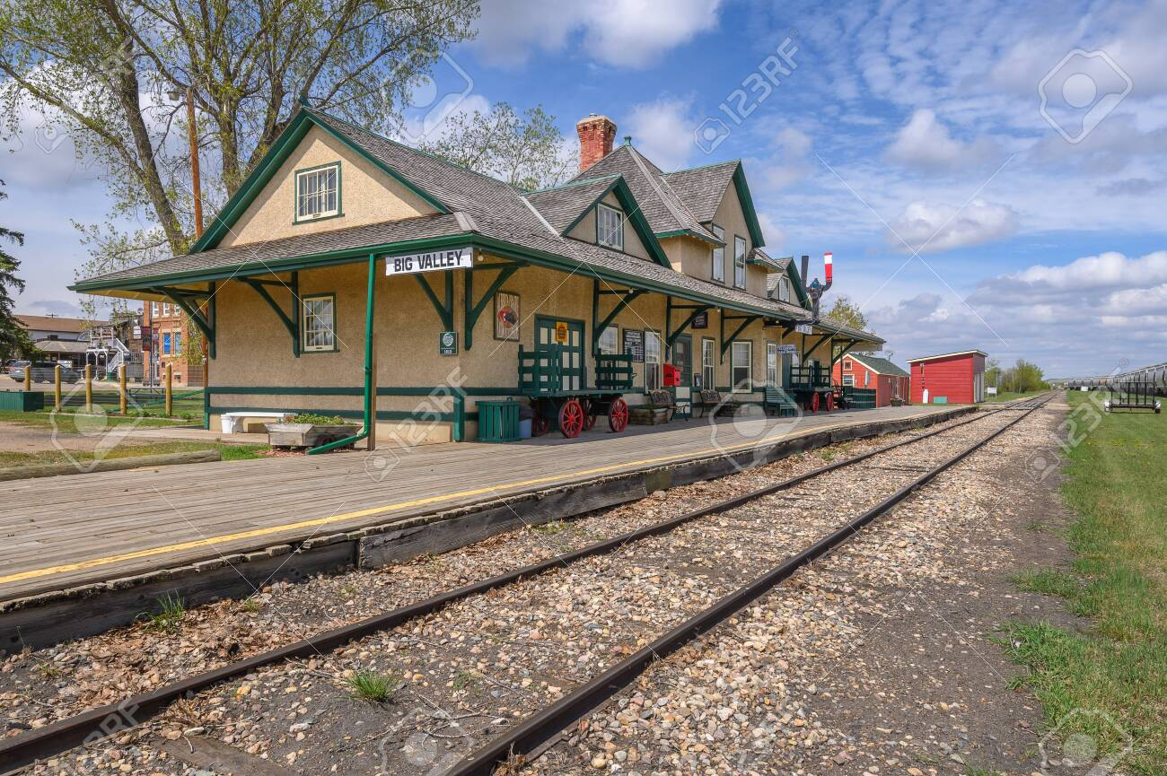 Big Valley, Alberta, Canada, May 19, 2020 - Exterior view of the railway station with platform and train tracks - 147687658