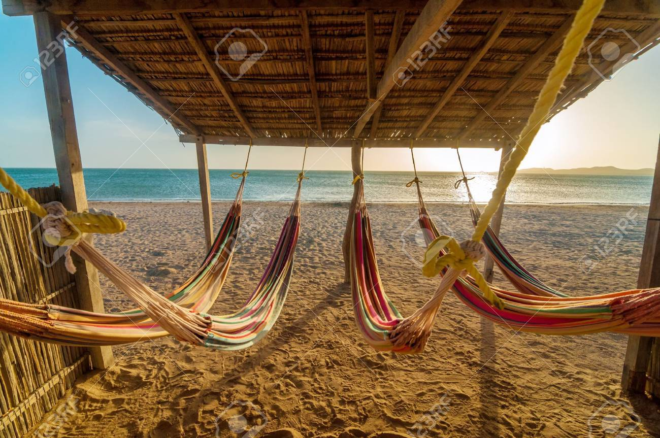 Hammocks on the beach - Bright Colorful Hammocks On The Beach At Sunset Stock Photo 18398199