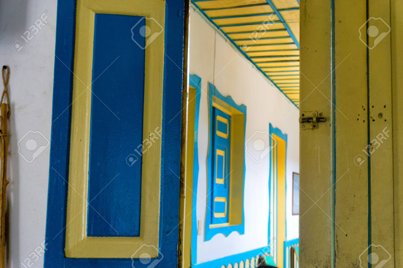 Old Colonial Door And Hallway With Blue And Yellow In Salento, Colombia  Stock Photo