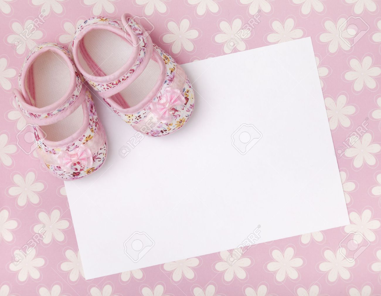 95b5b8c4398f Blank card with baby girl shoes on a pastel pink floral background. Stock  Photo