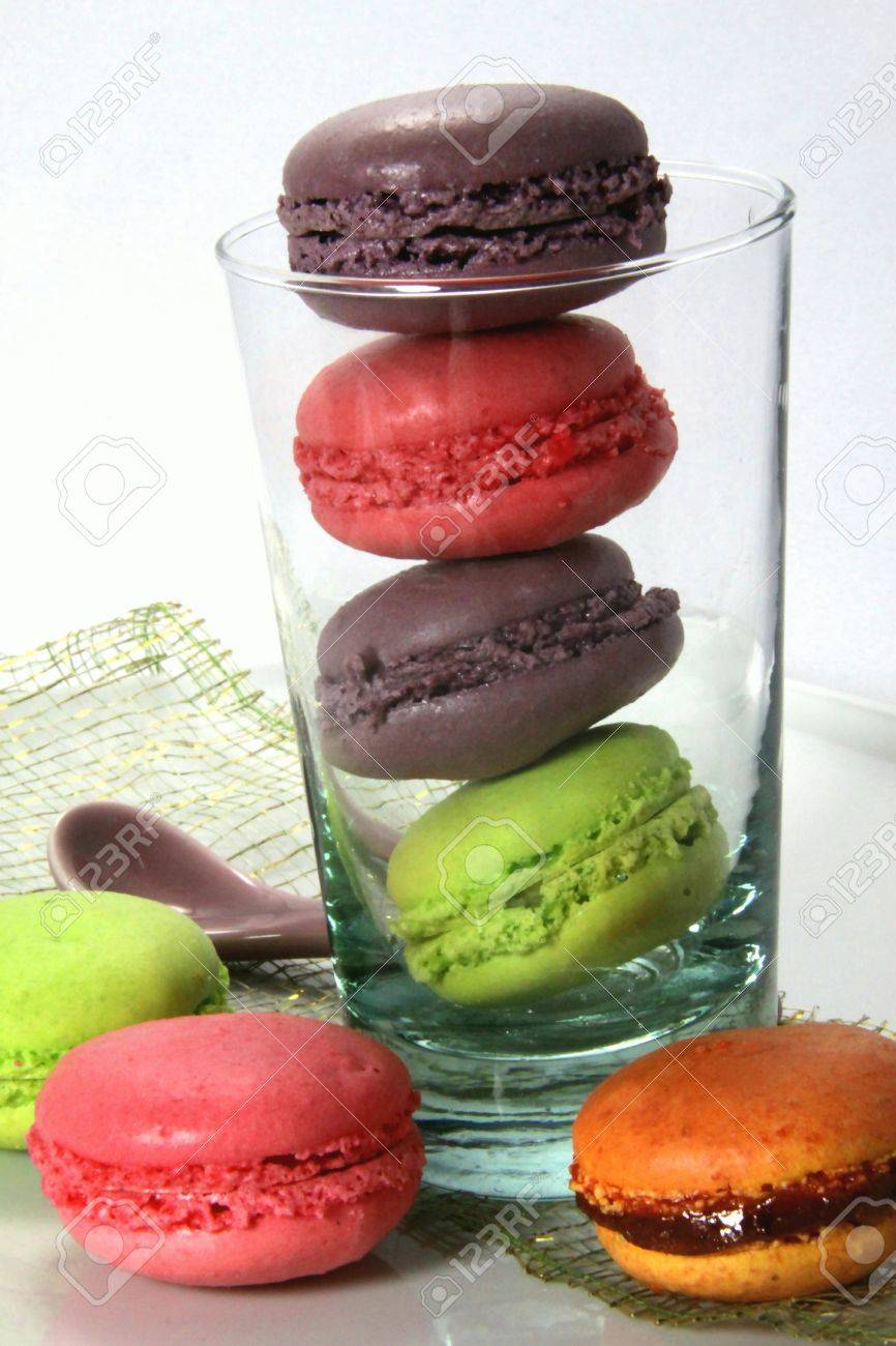 Tasting of multicolored macaroons Stock Photo - 10061392