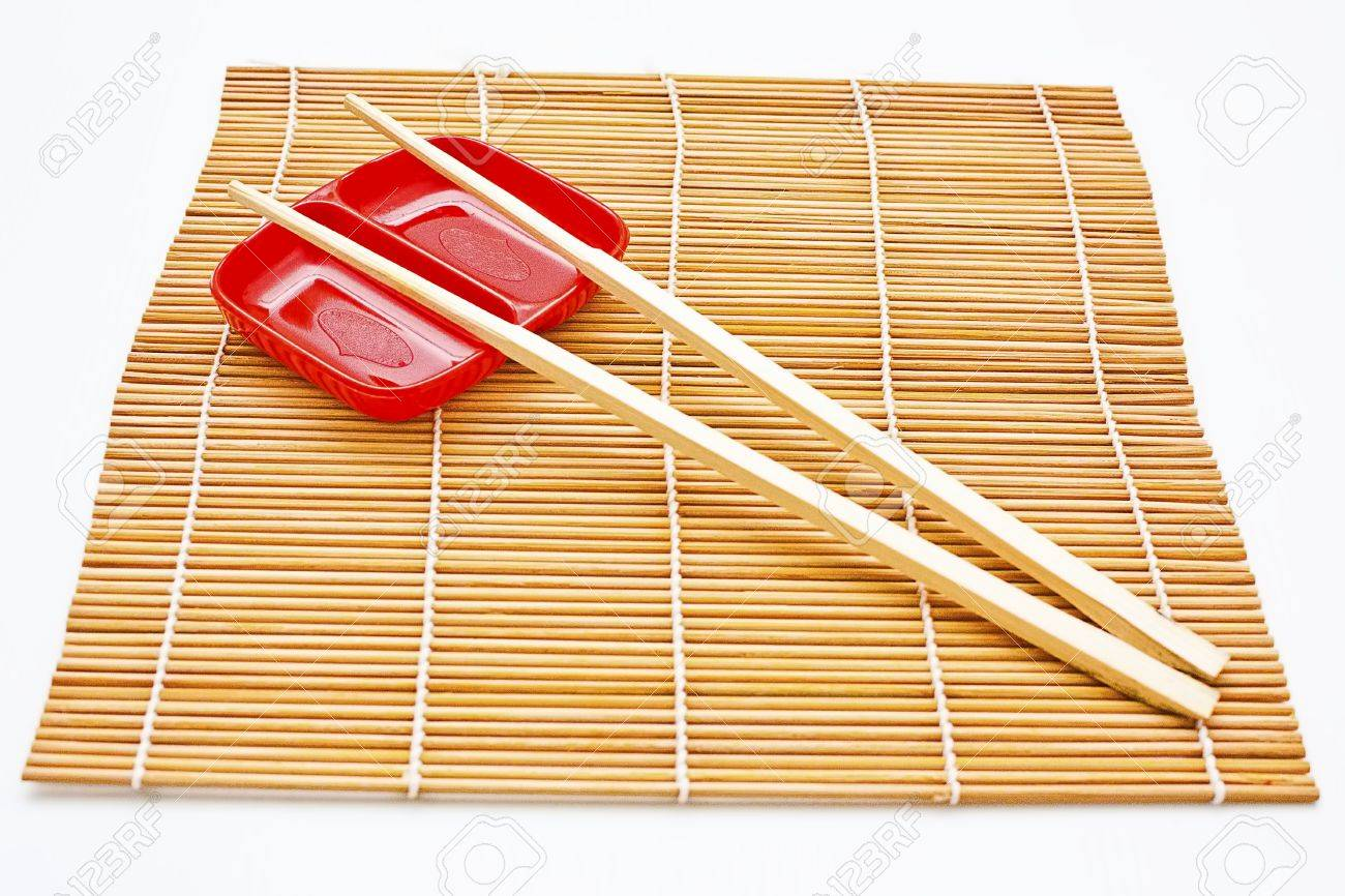 Dining table mats - Chopsticks Plate And Bamboo Table Mat From The Japanese Dining Culture Stock Photo
