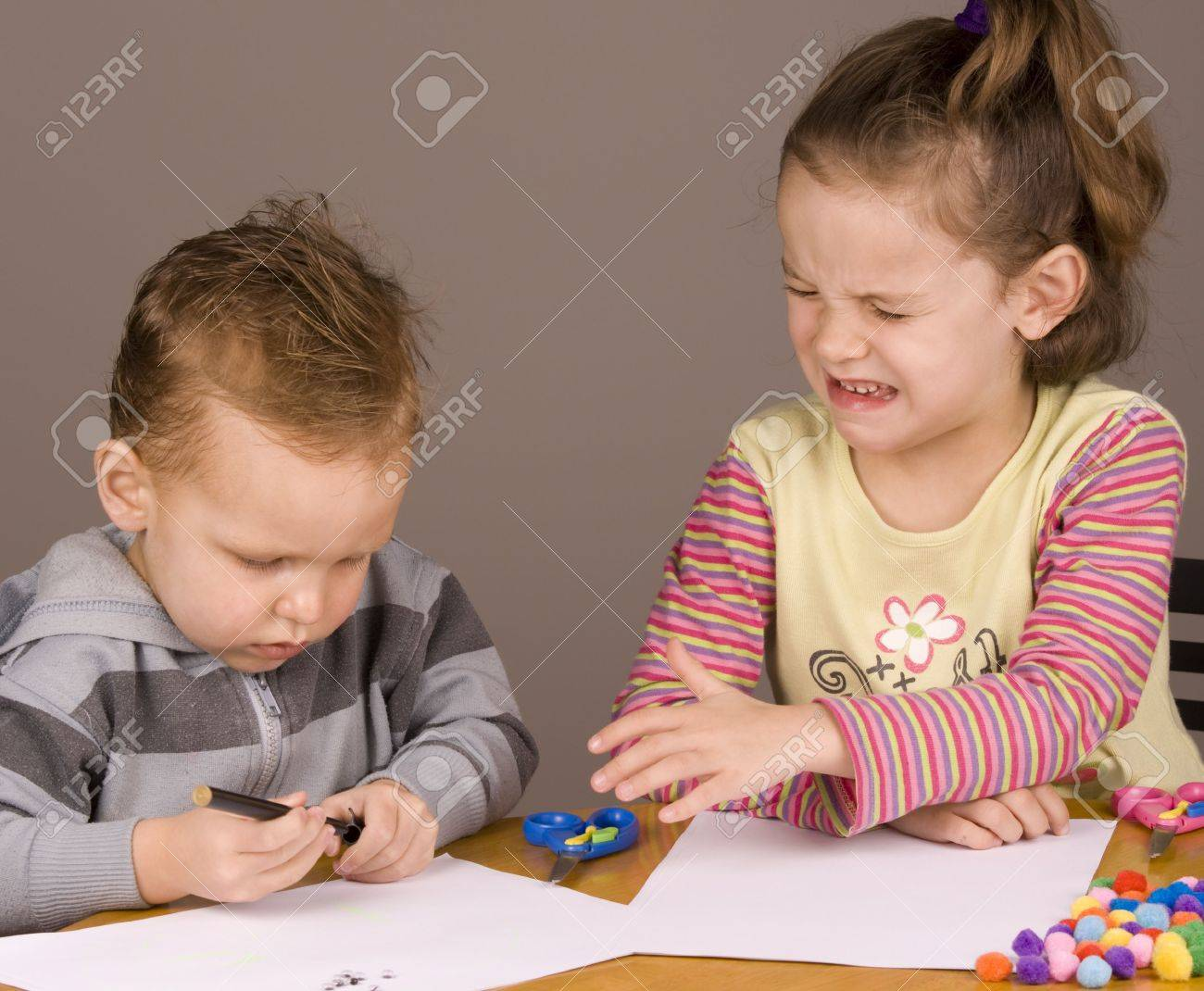 Girl crying because her brother took her pen Stock Photo - 5253585