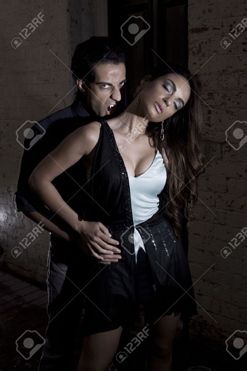 Vampire getting ready to bite a girl on the neck Stock Photo - 6056467