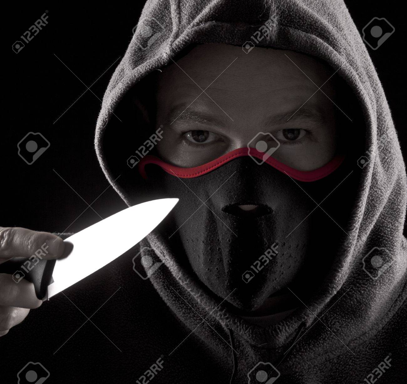 Man with a knife and mouth cover Stock Photo - 7416610
