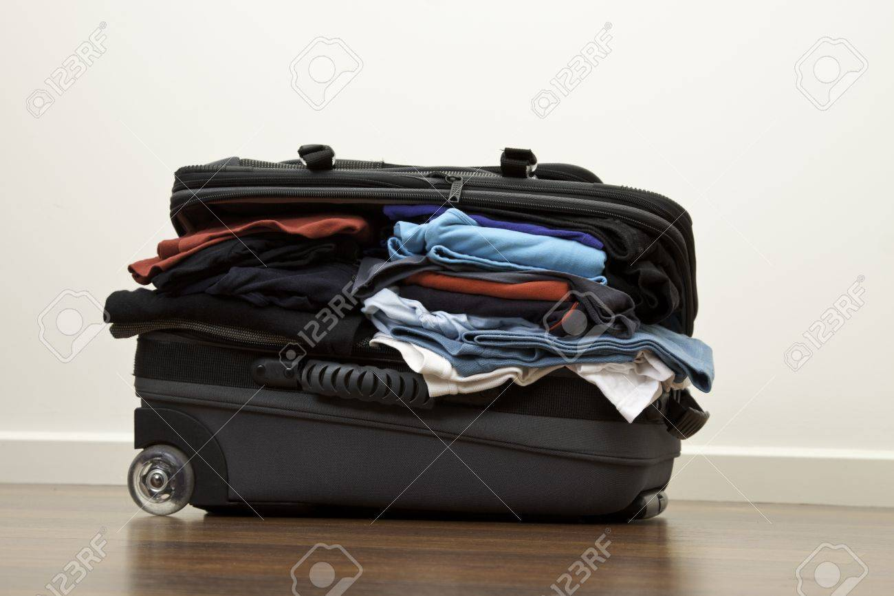 Suitcase stuffed with way to much clothes Stock Photo - 7917767
