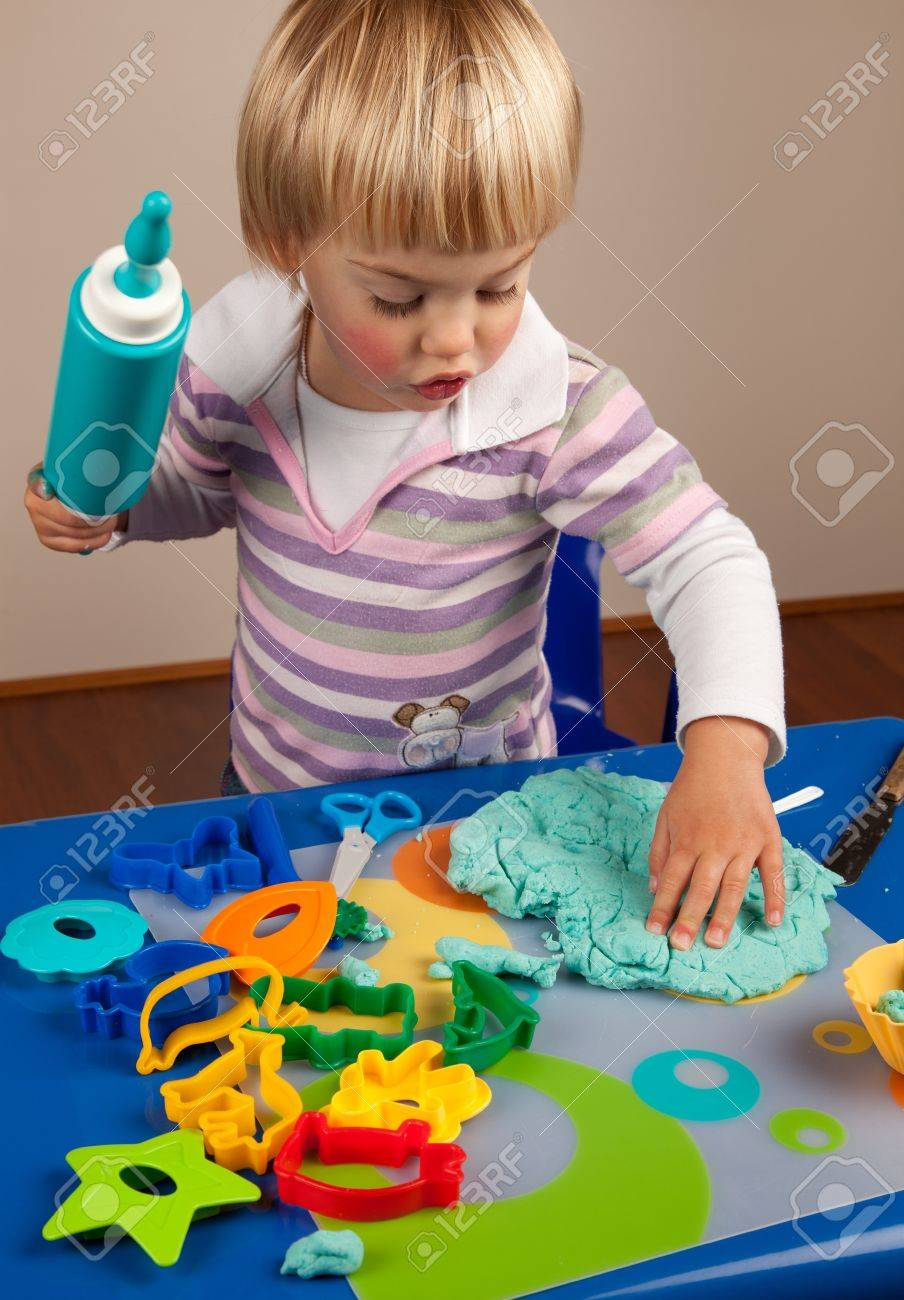 Little girl playing with play dough Stock Photo - 10088114