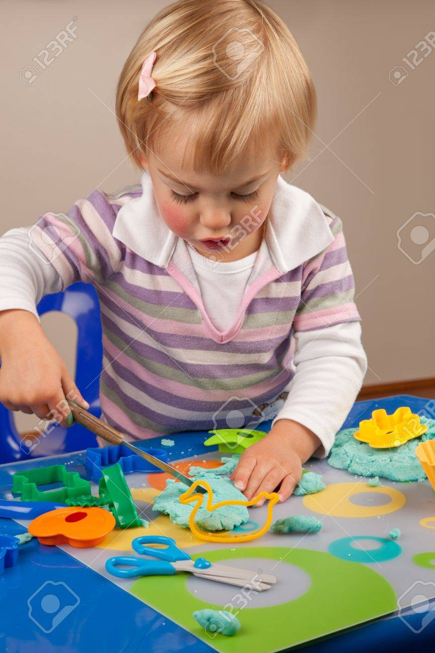 Little girl playing with play dough - 10088115